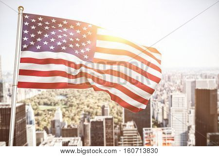 Close up of the us flag against aerial view of new york