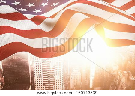 Focus on usa FLAG against aerial view of a city on a cloudy day