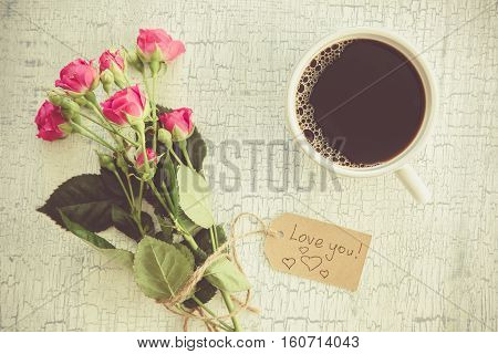 Morning coffee and flowers, copy space, top view