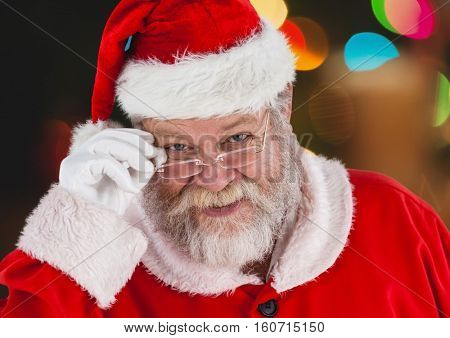 Portrait of santa claus holding spectacles and smiling