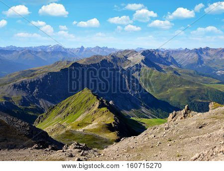 View from the mountain top Weissfluhjoch situated in the Plessur Range near Davos in canton Graubunden, Swiss alps.