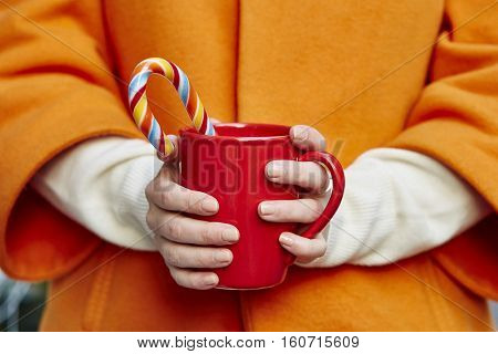 Hands With Mug And Candy