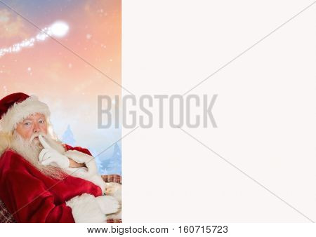 Santa claus with finger on lip against digitally generated background
