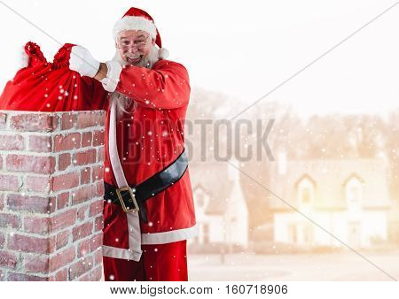 Santa removing gift sack from chimney against digitally generated background