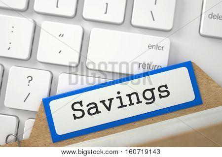 Savings. Blue Folder Index Overlies Modern Laptop Keyboard. Archive Concept. Closeup View. Selective Focus. 3D Rendering.