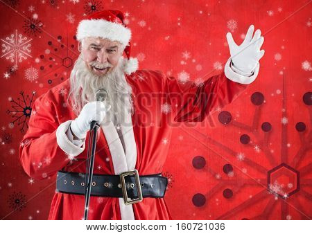 Rear view of santa claus with a microphone singing christmas songs against red background