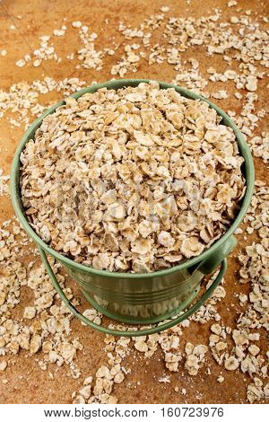 healthy scottish porridge in a green bucket