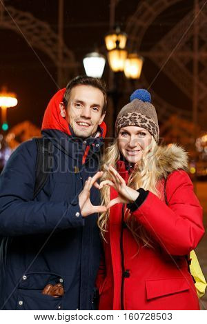 Beautiful lovers in new year on street at night