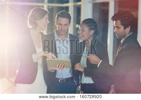 3D Group of businesspeople discussing together over digital tablet in office