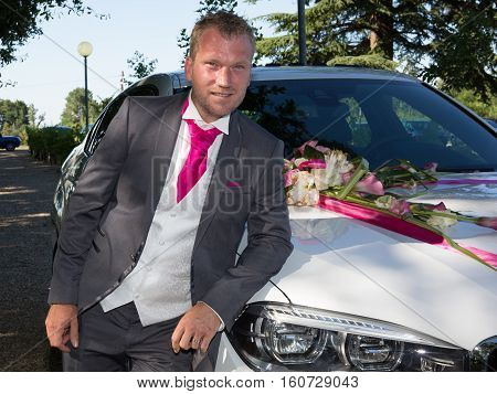 The Groom Posing With Luxury Marriage Car For Wedding Day
