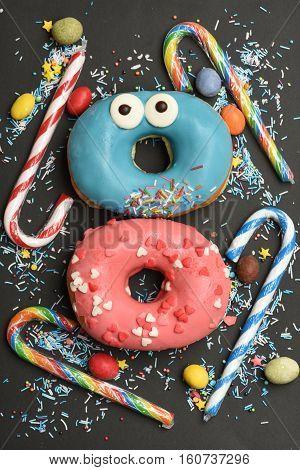 Funny Glazed Donuts On Black Background