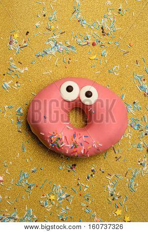 Funny Glazed Donut On Gold Background