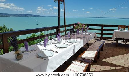 Table is ready to lunch, near the water.