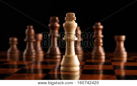 chess pieces with the king in the center