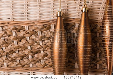 Christmas toys on wicker background. Copy space