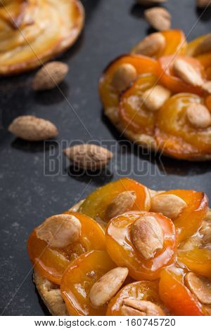 Tart With Apricot And Apple. Traditional French Pie With Fruits On Dark Marble Background. Decorated