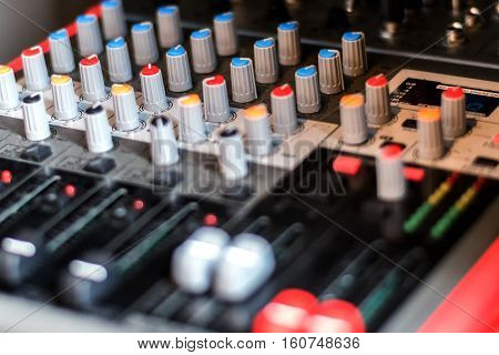 Close Up Electronic Professional Sound Mixer Control Panel In Music Studio