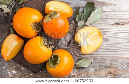 persimmon on wooden background