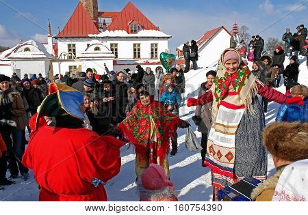 Gatchina, Leningrad region, Russia - March 5, 2011: Maslenitsa. a traditional spring holiday at the Russian peoples. Performers entertain spectators.