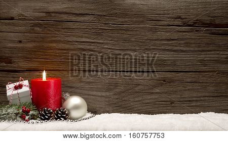 Snowy Christmas background with present and candle