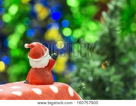 Santa Clause sitting on red polka dot waiting Christmas party