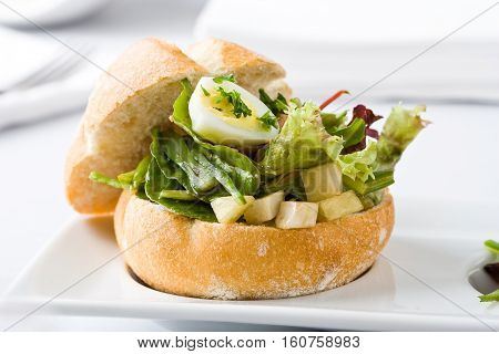 Streetfood: Healthy sandwich with vegetables and quail egg