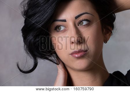 portrait of a beautiful young woman with elegant long shiny hair