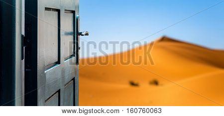 Opened Door Concept To Beautiful And Imaginary Desert Landscape