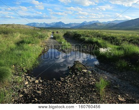 This is the road leading to Jack London lake in Siberia, Russia
