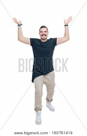 Young man in a black shirt as if holding a heavy object in his outstretched hands up over his head