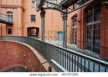 The metal structure and brick wall in an old brewery in Poznan