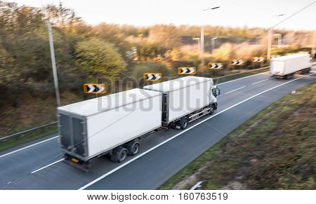 Lorry on the road blurred in motion with focus in the middle