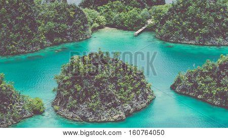 Painemo Island, Blue Lagoon, Raja Ampat, West Papua Indonesia. Vintage Look