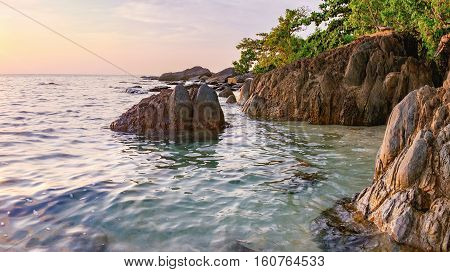 Panorama of beautiful seascape. Sea and rock at the sunset. Nature composition. Thai White Sand Beach in sunset time in Koh Chang island, Thailand.