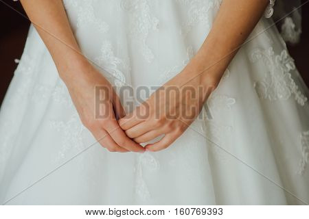 Bride's hands closeup at wedding.The bride waits for groom