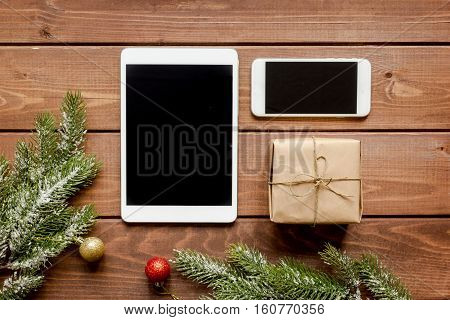 smartphone, tablet, shopping for new year online on wooden table top view.