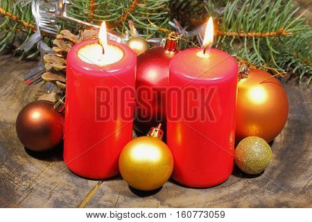 Advent candles with fir green and Christmas decoration