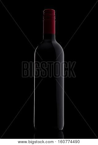 Bottle of red wine with shades on black background