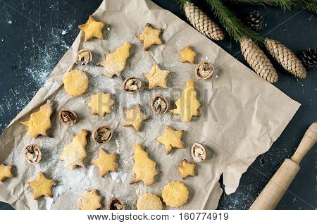 Corn cookies and walnuts with Christmas decoration flat lay.