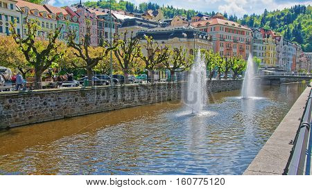 Fountain In Tepla River And Promenade In Karlovy Vary