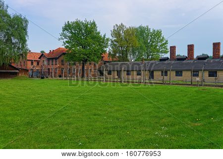 Crematorium and barracks at Auschwitz concentration camp Poland.