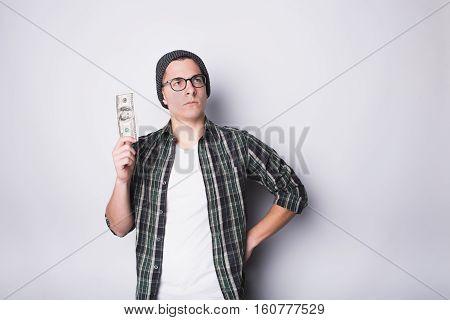 Man is satisfied with money he has and he is thinking seriously how to spend them in better way