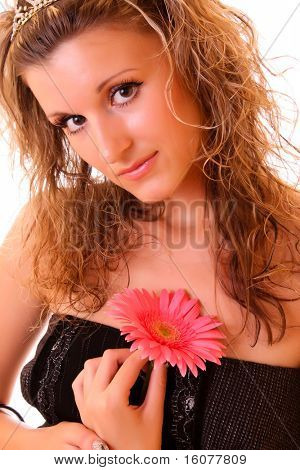 Young sexy woman with flower isolated on white