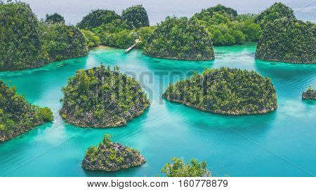 Group of Painemo Island surrounded by Blue Lagoon, Ocean, Raja Ampat, West Papua, Indonesia.Vintage Look