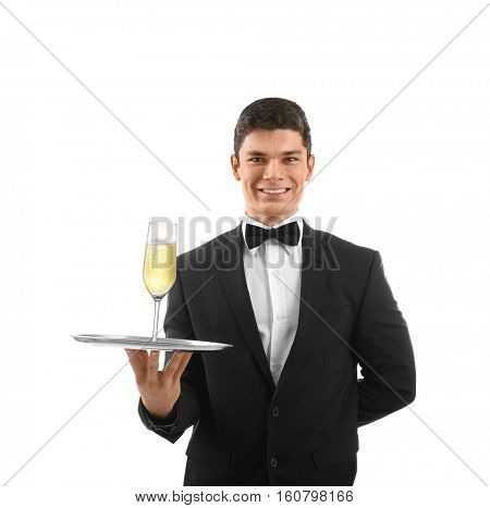 Male waiter holding tray with champagne on white background