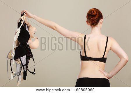 Woman Choosing Bras To Wear
