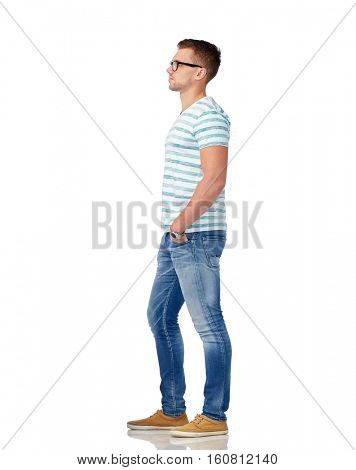 male, fashion and people concept - young man in eyeglasses over white