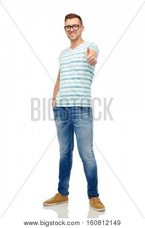 gesture and people concept - young smiling man in eyeglasses showing thumbs up over white