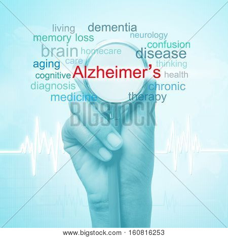 hand holding stethoscope with Alzheimer's disease word. medical concept
