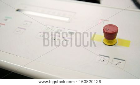 Folding machine on printing polygraph industry - red button and conveyer, close up, slider